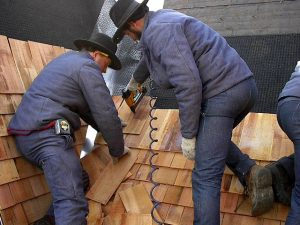 Amish crew install cedar shingles in Pella, Iowa
