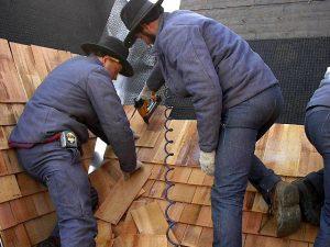 Amish crew install cedar shingles in Pella, Iowa